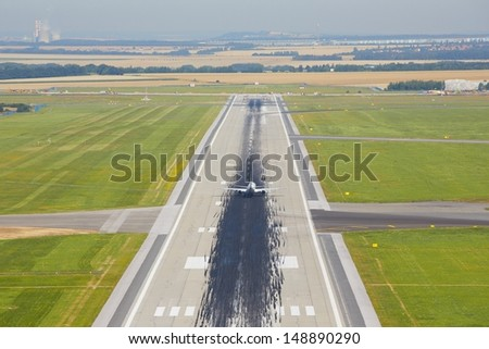 Marking on the beginning of the long runway - stock photo