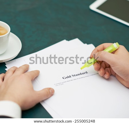 Marking words in a gold standart definition, shallow depth of field composition - stock photo