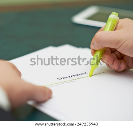 Marking words in a government definition, shallow depth of field composition - stock photo