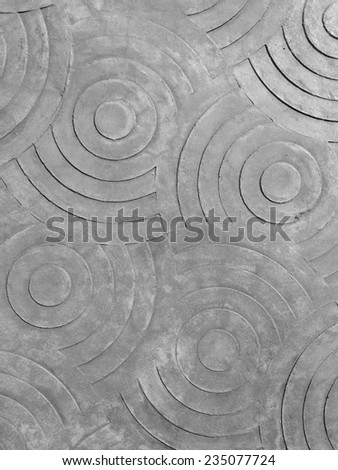 marks of circle on the concrete pavement. - stock photo