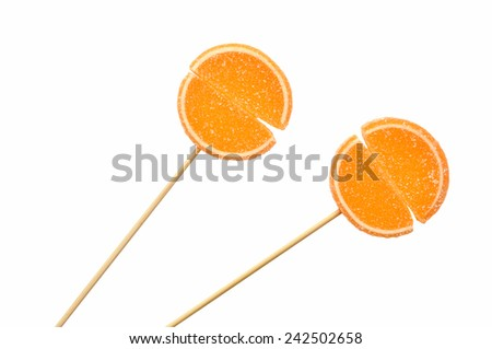 Marmalade candy on a stick isolated on white background - stock photo