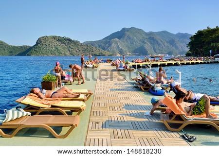 MARMARIS, TURKEY - JULY 24, 2013: Tourists at a popular Mediterranean resort on July 24, 2013 in Marmaris, Turkey. - stock photo