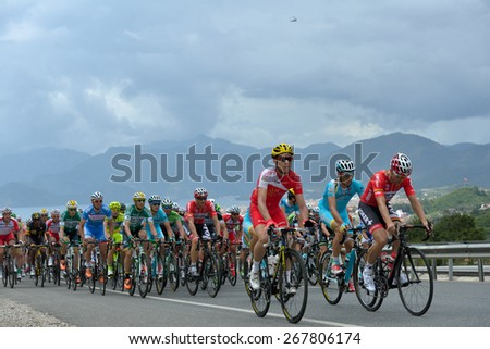 MARMARIS, TURKEY - MAY 1, 2014: Riders on the first climb of 5th stage of 50th Presidential Cycling Tour of Turkey. It is the only intercontinental cycling stage race from Europe to Asia - stock photo