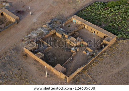 Maroc settlement in the desert near Marrakech aerial view - stock photo
