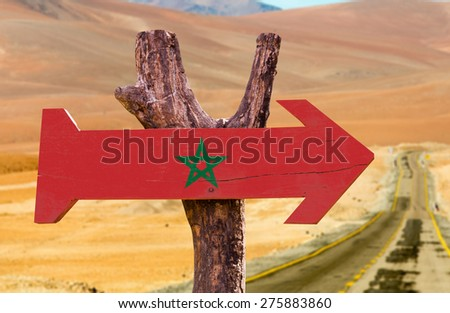Marocco Flag wooden sign with desert road background - stock photo