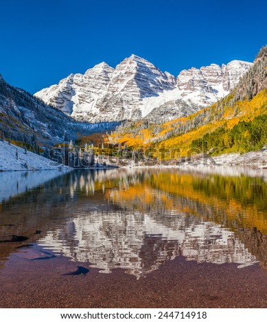 Maroon Bells national park in Falls after early snow storm - stock photo