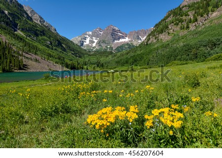 Maroon Creek Valley - A sunny spring view of Maroon Creek Valley, with Maroon Bells and Maroon Lake in the background, Aspen, Colorado, USA.