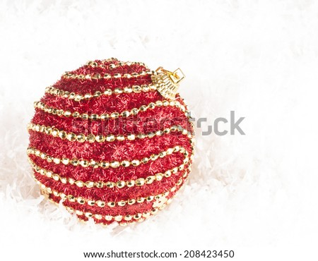 Maroon decorated bauble.