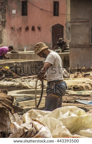 Marrakech, a hard working man in a tannery in Marrakech in Morocco.