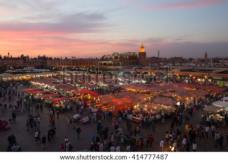 MARRAKECH, MOROCCO - APR 29, 2016: Food stalls at sunset on the Djemaa El Fna square. In the evening the large square fills with food stands, attracting crowds of locals and tourists.