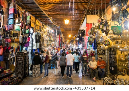 MARRAKECH, MOROCCO - APR 28, 2016: Tourists and locals walking through the souks in the old medina of Marrakech