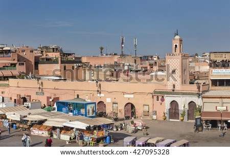 MARRAKECH, MOROCCO - APRIL 23, 2016: Jamaa el Fna (Jemaa el-Fnaa, Djema el-Fna or Djemaa el-Fnaa) square and market place with mosque in Marrakesh's medina quarter - stock photo