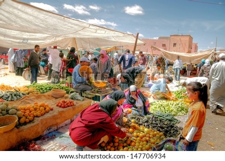 MARRAKECH, MOROCCO - april 5 2013; Weekmarket in the city of Marrakech on april 5 2013 ,Morocco. Morocco produces a large range of Mediterranean fruits and vegetables and even some tropical ones - stock photo