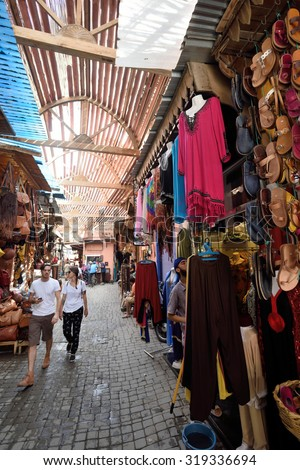 MARRAKESH - AUGUST 08: Unknown people in a market (souk), August 08, 2015 in a Marrakesh, Morocco. The traditional Berber market is one of the most important attractions of the city Marrakesh, Morocco - stock photo