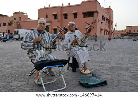 MARRAKESH - JULY 09: Unidentified musicians in Jemaa el Fna Square at sunset, July 09, 2013 in a Marrakesh, Morocco. The square is part of the UNESCO World Heritage - stock photo