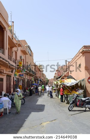 MARRAKESH, MAROCCO - AUGUST 24: Tourists visiting Marrakesh's medina quarter on 24 August 2014 in Marrakesh, Morocco. - stock photo