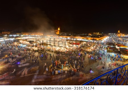 MARRAKESH, MOROCCO - APRIL 12, 2015: Djemaa el-Fna square at night getting busy with locals and tourists in the general street market buying and selling food and traditional merchandise. - stock photo