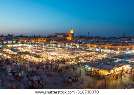 MARRAKESH, MOROCCO - APRIL 12, 2015: Djemaa el-Fna square at night getting busy with locals and tourists in the general street market buying and selling food and tradicional merchandise. - stock photo