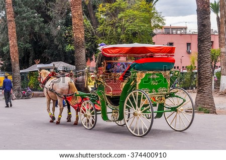 MARRAKESH, MOROCCO, APRIL 2, 2015: Jemaa el-Fnaa square - Horse drawn carriage for tourists - stock photo
