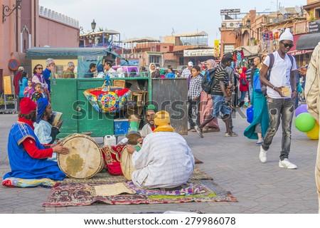 MARRAKESH, MOROCCO, APRIL 4, 2015: Local musicians in Jemaa el-Fnaa square - stock photo