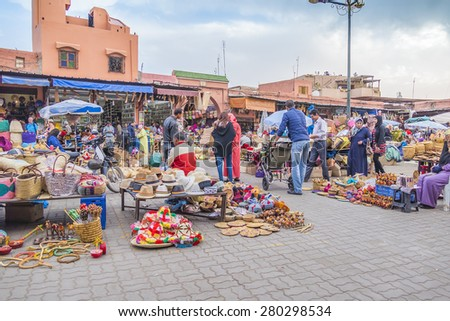 MARRAKESH, MOROCCO, APRIL 4, 2015:  Local sellers offer baskets and other souvenirs on street stands in souks - stock photo