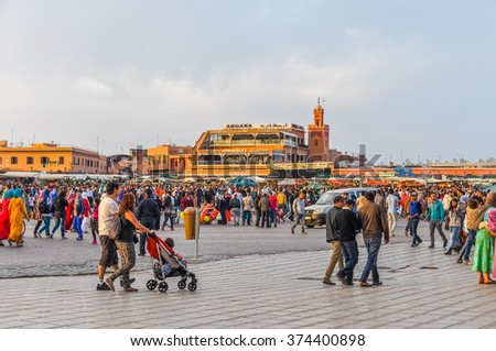 MARRAKESH, MOROCCO, APRIL 3, 2015: People walk on Jemaa el-Fnaa square - stock photo