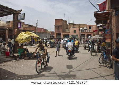 MARRAKESH, MOROCCO - AUG 8: Unidentified people at street in Marrakesh on Aug 8, 2010 in Marrakesh, Morocco. With population of over 900,000 inhabitants is the most important imperial city in Morocco. - stock photo