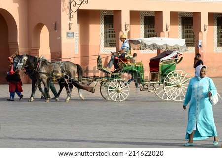 MARRAKESH, MOROCCO - AUGUST 24: Coachman waiting for tourists on the market place in Marrakesh's medina quarter on 24 August 2014 in Marrakesh, Morocco. Djemaa el Fna is a UNESCO world heritage site. - stock photo