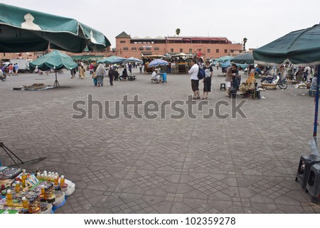 MARRAKESH, MOROCCO - AUGUST 8: Unidentified people visit the Jema el Fna Square in Marrakesh on August 8, 2010 in Marrakesh, Morocco. The square is part of the UNESCO World Heritage. - stock photo