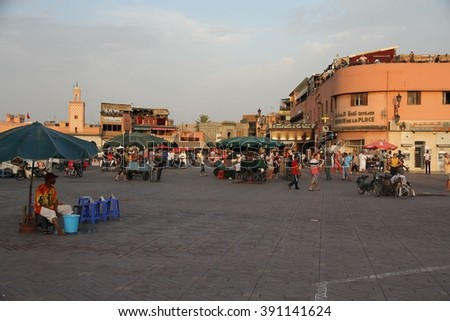 MARRAKESH, MOROCCO - JULY 11: A panoramic view in the late afternoon of the Jemaa el Fna square of Marrakesh, Morocco on the 11th July, 2015. - stock photo