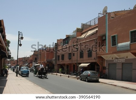 MARRAKESH, MOROCCO - JULY 11: A side streetscape near the Jemaa el Fna square of the Old Town of Marrakesh, Morocco on the 11th July, 2016. - stock photo