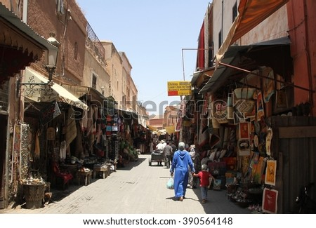 MARRAKESH, MOROCCO - JULY 11: An alleyway off the the Jemaa el Fna square of the Old Town of Marrakesh, Morocco on the 11th July, 2016. - stock photo