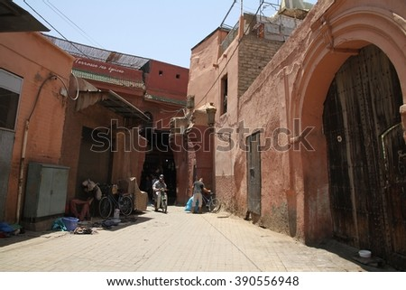 MARRAKESH, MOROCCO - JULY 11: Local people in a corner of the Jemaa el Fna square of the Old Town of Marrakesh, Morocco on the 11th July, 2016. - stock photo