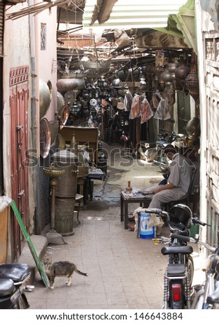 MARRAKESH ,MOROCCO - JUNE 4: Unidentified man in the souk of Marrakesh on June 4, 2013 in Marrakesh. In 2009 the medina got part of UNESCO World Heritage.