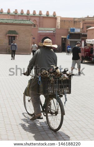 MARRAKESH ,MOROCCO - JUNE 4: Unidentified people at a street in Marrakesh on June 4, 2013 in Morocco. In 2009 the medina got part of UNESCO World Heritage. - stock photo