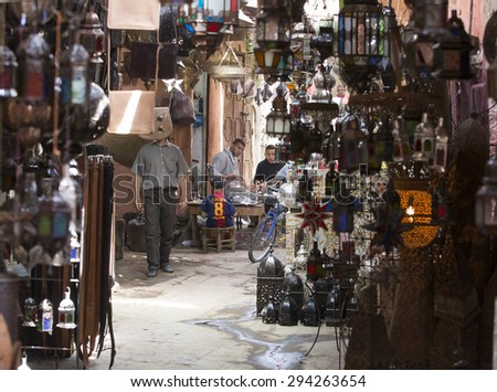 MARRAKESH ,MOROCCO - JUNE 4: Unidentified people in the medina of  Marrakesh on June 4, 2013 in Morocco. With a population of over 900,000 inhabitants it is the most important city in Morocco. - stock photo