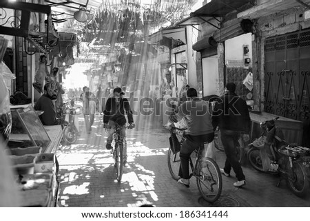 MARRAKESH ,MOROCCO - MARCH 6: Unidentified people at a street in Marrakesh on MARCH 6, 2014 in Morocco. With a population of over 900,000 inhabitants it is the most important city in Morocco.