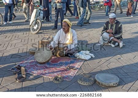 MARRAKESH, MOROCCO - NOV 22: Snake charmer at the Jemaa el-Fnaa square in Marrakesh. November 22, 2008 in Marrakesh, Morocco - stock photo