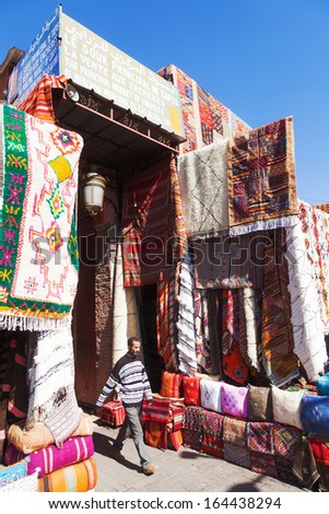 MARRAKESH, MOROCCO - NOVEMBER 14: market stall with Arabian carpets in the Souks of the Medina on November 14, 2013 in Morocco. The medina is listed under the UNESCO world heritage sites. - stock photo