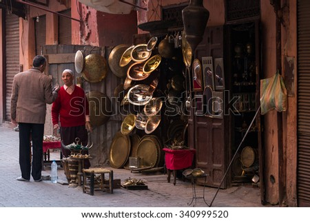 MARRAKESH ,MOROCCO - NOVEMBER 12: Unidentified man in front of his traditional shop in Marrakesh on November 12, 2015 in Morocco. Marrakech it is the most important city in Morocco.  - stock photo