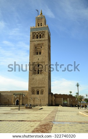 MARRAKESH, MOROCCO - NOVEMBER 23: Unidentified people and Koutoubia mosque, landmark and tourist attraction of the city, on November 23, 2014 in Marrakesh, Morocco