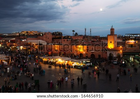 MARRAKESH, MOROCCO - NOVEMBER 16: unidentified people on the square Jemaa el Fna at night on November 16, 2013 in Marrakesh. As part of the old town it is part of the UNESCO world heritage sites.