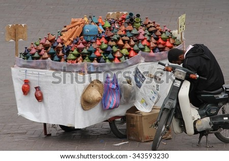 MARRAKESH, MOROCCO - OCTOBER 8: A local man with his stall selling tajine dishes in the Jemaa el-fna square in Marrakesh, Morocco on the 8th October, 2015. - stock photo