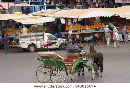MARRAKESH, MOROCCO - OCTOBER 8: A traditional horse and carriage in the Jemaa el Fna Square in Marrakesh, Morocco on the 8th October, 2015. - stock photo