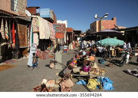 MARRAKESH, MOROCCO - OCTOBER 9th: A panoramic view of a square in the souks of Marrakesh, Morocco on the 9th October, 2015. - stock photo
