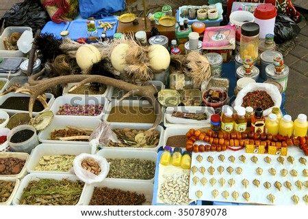MARRAKESH, MOROCCO, SEPT 20: Food Stalls with medicinal plants, herbs, and roots in Djemaa el Fna, Marrakesh, Morocco 2006 - stock photo