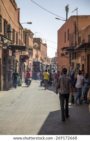 MARRAKESH, MOROCCO - SEPTEMBER 11, 2015: Unidentified people on the street of Marrakesh, Morocco. Marrakesh is the fourth largest city in Morocco. - stock photo