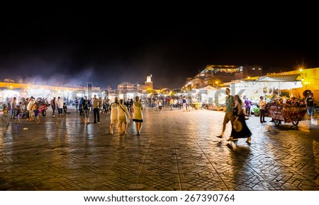 MARRAKESH, MOROCCO - SEPTEMBER 19: unidentified people walking down the main market square Djemma El Fna at night in Marrakesh on September 19, 2014. - stock photo