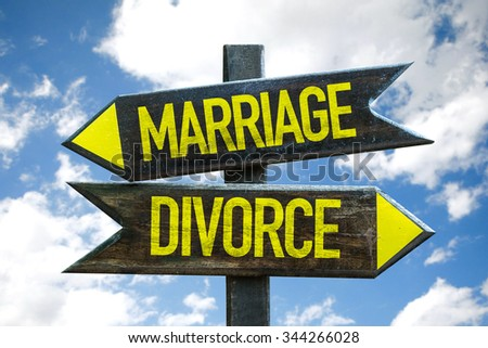 Marriage - Divorce signpost with sky background - stock photo
