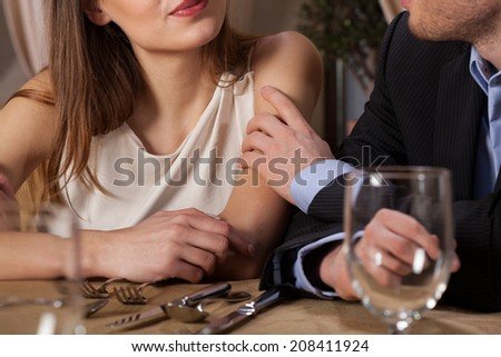 Marriage having dinner in a restaurant, horizontal